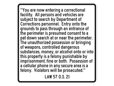 "Picture of ""You are now entering a correctional facility Possession of a cellular phone in any secure area is a felony. Violators will be prosecuted."""